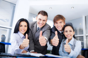 Happy-Business-People-Thumbs-Up